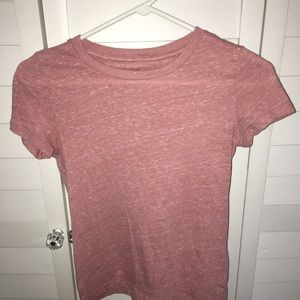 pink tee with white detailing throughout